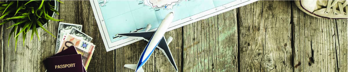 an airplane, passport and map on a table