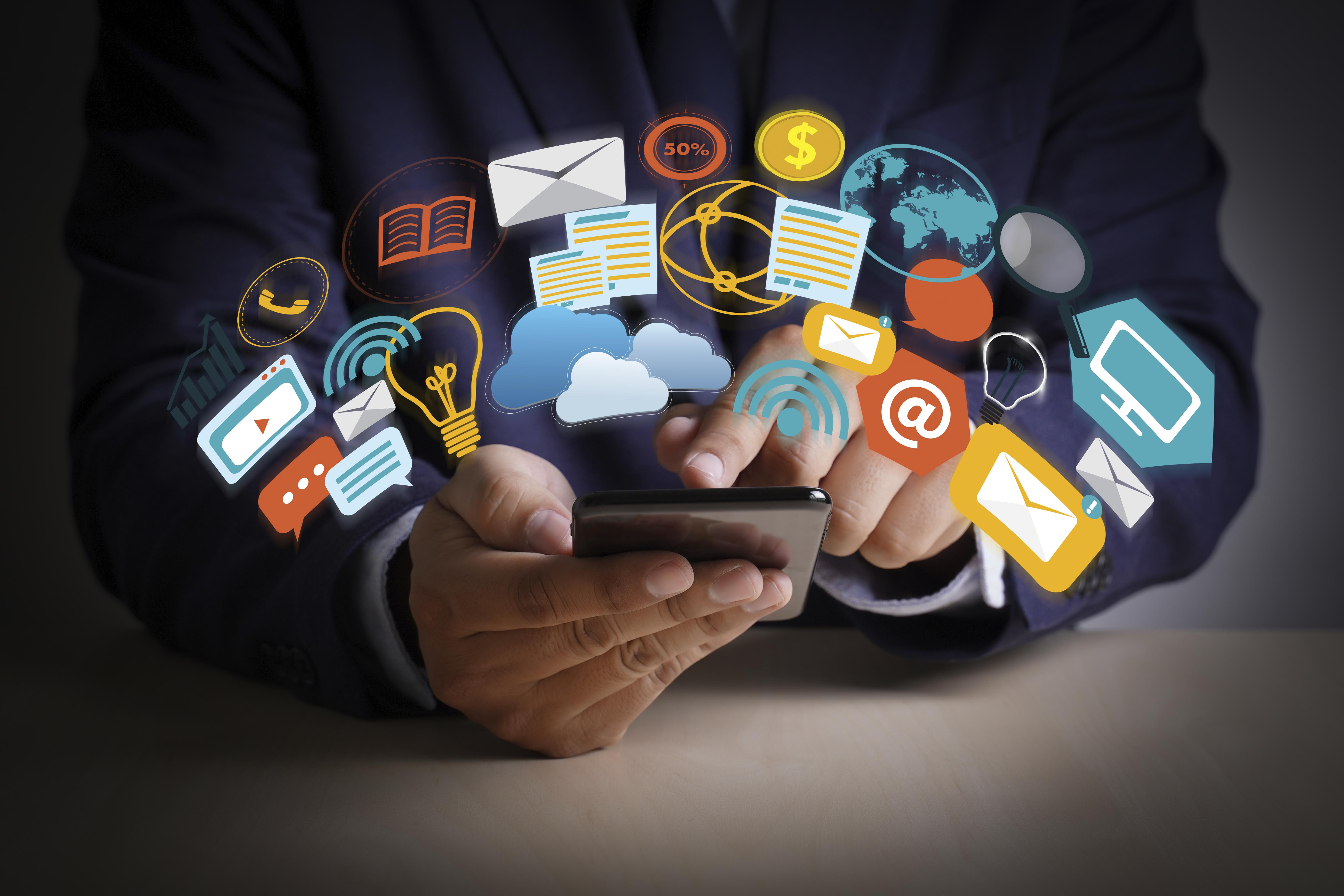 man interacting with a variety of applications on his smart phone