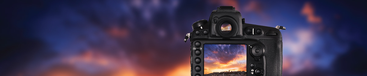 camera taking a photo of a sunset