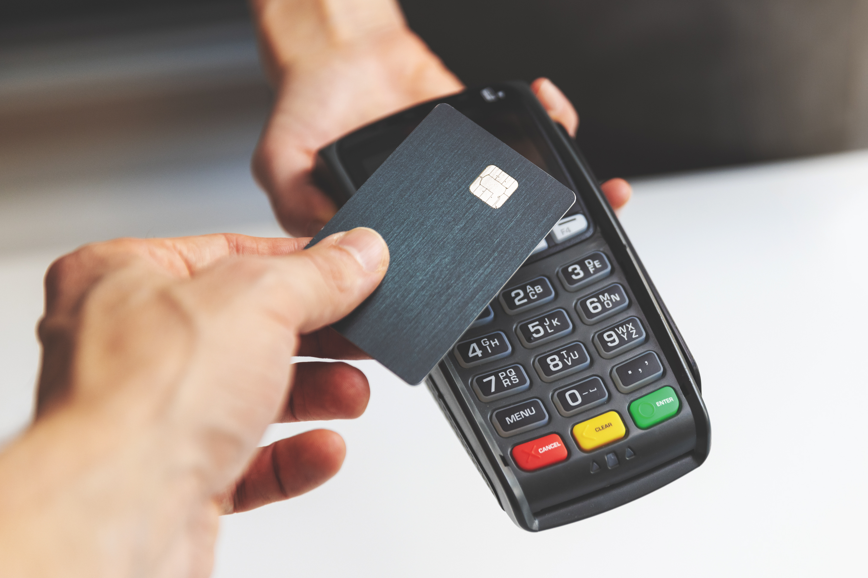 person using contactless payment with their credit card